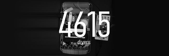 "White text reading ""4615 divers"" on a black and white photo of a tape recorder and electrnic components"