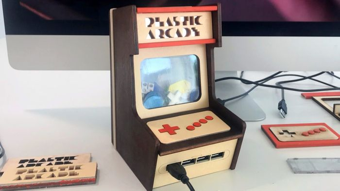 A miniature arcade cabinet made of lasercut wood panels